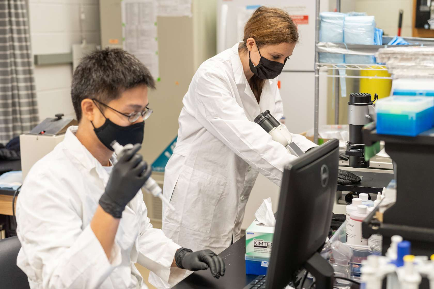 Dr. Leah Reznikov, an assistant professor of physiological sciences, is shown in her laboratory with biological scientist Jackson Liao.